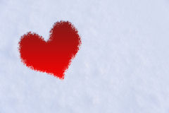 The shape of heart on the snow. Stock Photos
