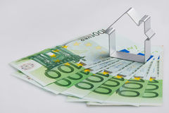 Shape of house and money Royalty Free Stock Photography