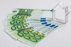 Shape of house and money Stock Photos
