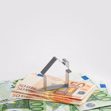 Shape of house and money Stock Image
