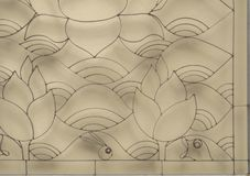 Curved steel. Shape of lotus and wave curved steel which has sunlight shadow on the wall background Royalty Free Stock Image