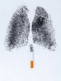 Shape of lungs with charcoal powder. And cigarette on white background Stock Photos