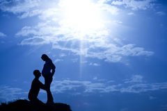 Shape of man and pregnant woman. Shape of a man and a pregnant woman on a hill Royalty Free Stock Photo
