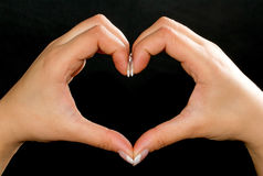 Shape of my heart. Shape of heart made by hands Stock Images