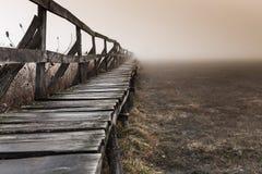 Shape of a pier near a lake, wintertime on a foggy morning, in Sic illage, nsylnia, Romania.  stock photo