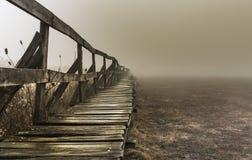 Shape of a pier near a lake, wintertime on a foggy morning, in Sic village, Transylvania. Romania stock image