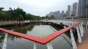 The shape of the railings along the lake. Bright red railings on the lake stock photos