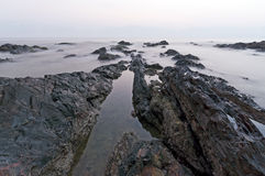 Shape of Rock at Pandak Beach during sunrise, Terengganu, Malaysia Stock Photography