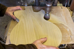 Shape sanding a guitar body Stock Image