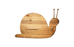 The shape of snail on old wood surface. Stock Images