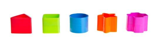 Shape Sorter. Stacks of  Toy Blocks on background Stock Photos
