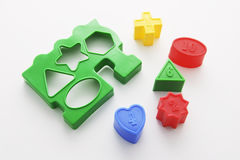 Shape Sorter Toy. On Seamless Background royalty free stock photography