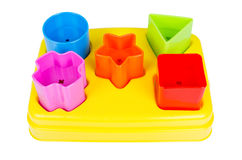 Shape sorter toy with various coloured blocks isolated Royalty Free Stock Images