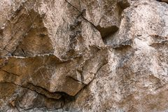 Shape of stone texture wall. Brown Stone texture detail wall outdoor light Royalty Free Stock Photo