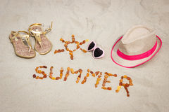 Shape of sun and word summer, accessories for vacation on sand at beach, sun protection, summer time Stock Photos