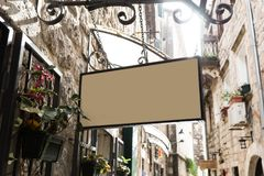 Shape traditional bar signage mockup in old city center stock photography