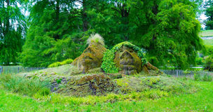 The shape of two faces in the grass on the island of Mainau in the center of Europe. stock images