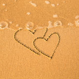 Shape of the two hearts of the sea on the beach. In Valentine Day. Soft wave of the sea Stock Images