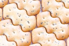 Shaped browned crisp biscuits as tile background Royalty Free Stock Photos