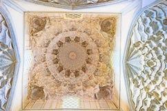 The shaped ceiling. SAMARKAND, UZBEKISTAN - May 1, 2015: The interior of Kazi Zade Rumi mausoleum with the beautiful ceiling made of carved plaster, Shah-i-Zinda Royalty Free Stock Images