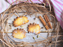 Shaped cookies. On a wooden table with decor paper and towel stock photo