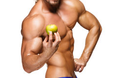 Shaped and healthy body man holding a fresh apple Stock Photos