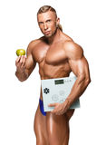 Shaped and healthy body man holding a fresh apple Royalty Free Stock Image