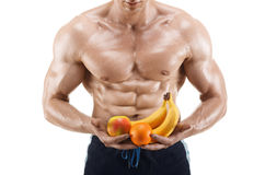 Shaped and healthy body man holding a fresh fruits, shaped abdominal, isolated on white Stock Image