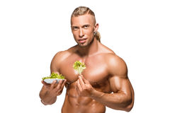 Shaped and healthy body man holding a fresh Stock Image