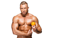 Shaped and healthy body man holding a fresh orange Stock Image