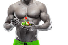 Shaped and healthy body man holding a fresh salad bowl. Shaped abdominal, isolated on white background, colored retouched stock image