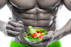 Shaped and healthy body man holding a fresh salad bowl. Shaped abdominal, isolated on white background, colored retouched royalty free stock image