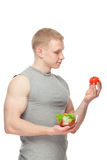 Shaped and healthy body man holding a fresh salad Royalty Free Stock Photography