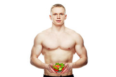 Shaped and healthy body man holding a fresh salad Stock Photos