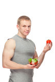 Shaped and healthy body man holding a fresh salad Royalty Free Stock Images