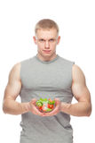 Shaped and healthy body man holding a fresh salad Royalty Free Stock Photos