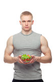 Shaped and healthy body man holding a fresh salad Stock Image