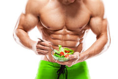Shaped and healthy body man holding a fresh salad bowl,shaped ab Royalty Free Stock Photo