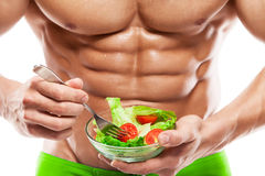 Shaped and healthy body man holding a fresh salad bowl,shaped ab Stock Photos