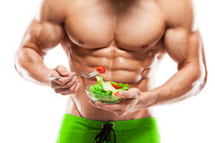 Shaped and healthy body man holding a fresh salad bowl,shaped ab royalty free stock photography