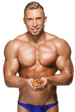 Shaped and healthy body man holding a walnuts Royalty Free Stock Images
