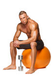 Shaped and healthy body man sitting on fitness Stock Image