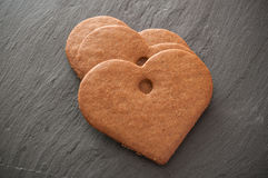 Shaped heart biscuits on chalkboard background royalty free stock photos