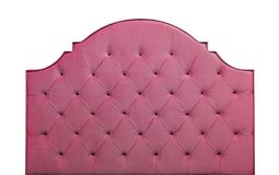 Pink velvet bed headboard isolated on white. Shaped pastel purple pink color soft velvet fabric capitone bed headboard of Chesterfiels style sofa isolated on stock image