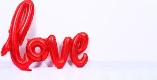 Shaped red balloon of word Love royalty free stock images