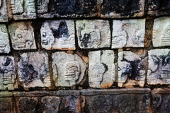 Shaped stones on wall of Chichen Itza monument Royalty Free Stock Photos