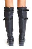 Shapely женские ноги в высоких кожаных ботинках изолированная белизна вид сзади Стоковые Фото