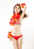 Shapely Asian Woman in Red Bright Swimsuit with Origami. Fashion Style. Girl in Swimsuit with Origami. Fashion Model royalty free stock images