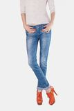 Shapely female legs dressed in blue jeans Stock Photography