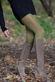 Shapely female legs are on the fall foliage Royalty Free Stock Photos